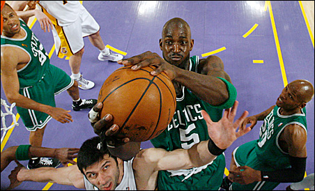 bc4cbc7b0aeafc Boston Celtic Kevin Garnett grabs a rebound over Los Angeles Laker Vladimir  Radmanovic as P.J. Brown