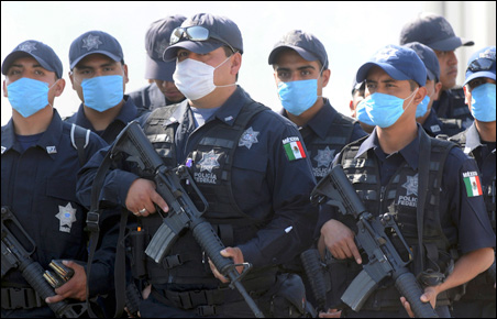 Mexican Federal Policemen wore masks in Mexico City last Saturday.