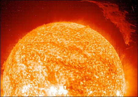 In 2004, NASA's Sun-orbiting SOHO spacecraft imaged a large solar prominence hovering over the surface (upper right).