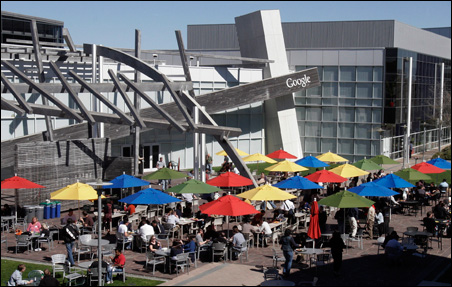 Employees take their lunch break in the sun at Google headquarters in Mountain View, Calif.