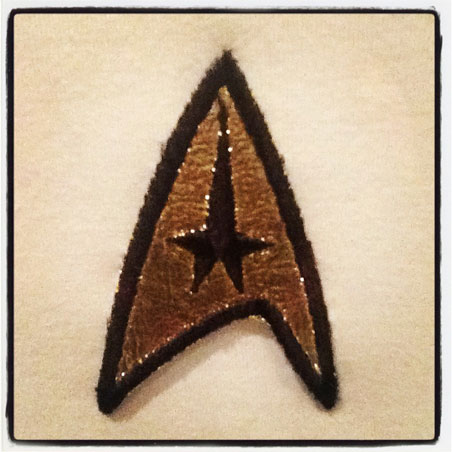 "Captain Kirk's actual insignia patch from ""The 1968 Exhibit."""