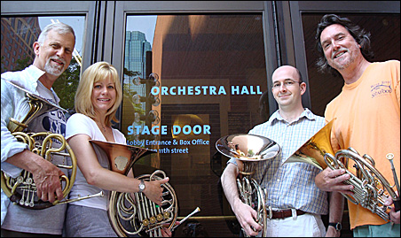 Chamber Music Series organizer Ellen Dinwiddie Smith, second from left, with other members of the Minnesota Orchestra horn section: David Kamminga (far left) and Brian Jensen and Michael Gast.