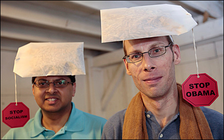 Gary, right, and Samuel, left, wear 'Stop Obama, Stop Socialism' tea bag hats they were selling at a Tea Party Political Fair in Charlotte, Michigan, this summer.