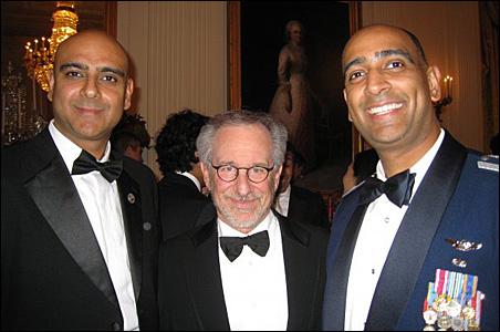 State Sen. Satveer Chaudhary left, Steven Spielberg, and Col. Ravi Chaudhary.