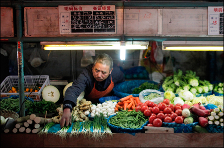 A vendor displays vegetables at a local food market in Shanghai.