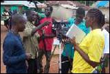 Video team leader Albert D. Pyne, left, training volunteers in Boway Town, Liberia, last June.