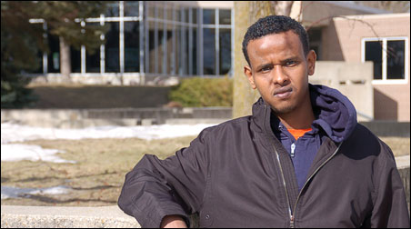 Abdalla Mohamed, 22, a sophomore at Ridgewater College, is pictured in the courtyard of the college's Willmar campus.