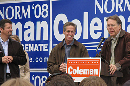 Todd Palin, left, Sen. Norm Coleman and NRA CEO Wayne LaPierre share the stage at a rally for Coleman at the Hermantown Gander Mountain parking lot.