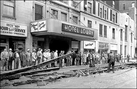 The removal of trolley tracks near the intersection of Fourth and Wabasha in downtown St. Paul, 1955.