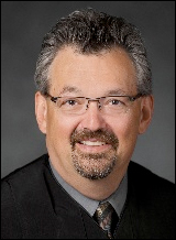 Ex-Chief Justice Eric Magnuson