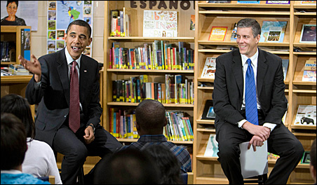 President Barack Obama sits next to U.S. Secretary of Education Arne Duncan as they visit the Wright Middle School in Madison, Wisc., last fall.