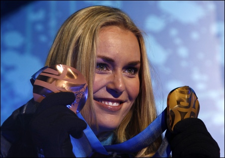 Lindsey Vonn poses with the gold medal that she won in the women's downhill skiing and the bronze that she won in the Super-G during a presentation ceremony on Saturday.