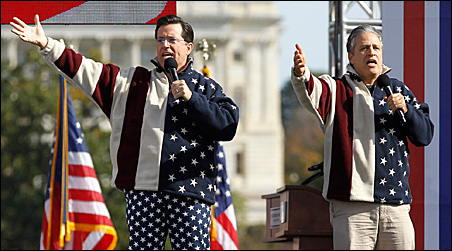 Jon Stewart, right, and Stephen Colbert sing during the Rally to Restore Sanity and/or Fear on the Washington Mall on Saturday.