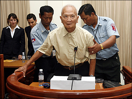 """The most senior surviving leader of the Khmer Rouge, """"Brother Number Two"""" Nuon Chea, is assisted by police officers last month at the Extraordinary Chambers in the Court of Cambodia."""