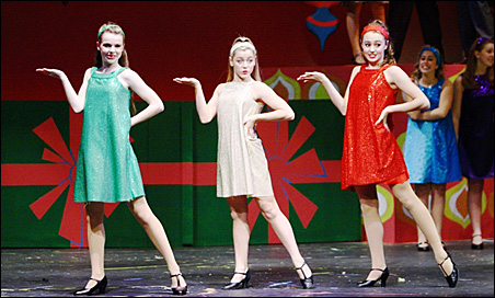 """Singing and dancing take center stage in the new holiday production """"A Hill-Murray Christmas: Let's Go to the Movies."""" From left are  Jacqueline Schneider, Kelsey Sutter and Jessica Jaunich."""