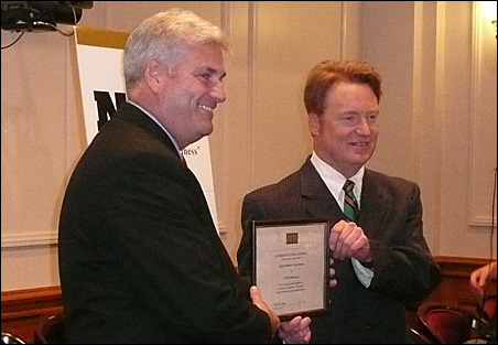 """Tom Emmer receives the """"Guardian of Small Business"""" award from state NFIB representative Mike Hickey."""