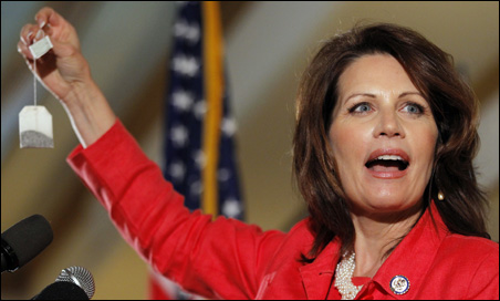 Rep. Michele Bachmann holds up a tea bag while speaking in Nashua Saturday.