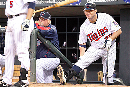 Twins manager Ron Gardenhire, left, and designated hitter Jim Thome during the June 29 game against the Detroit Tigers.