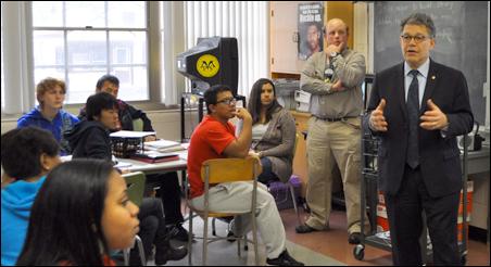 Sen. Al Franken addresses a class at Patrick Henry High School.