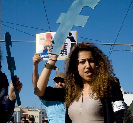 """A protester in Rabat, Morocco, holds a """"f"""" in recognition Facebook's role in the North African revolts, during a protest in March."""