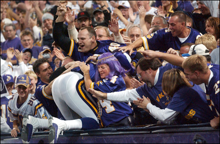 Fan enthusiasm when the Vikings do well can help produce a more productive workplace and add an economic boost, two professors say.