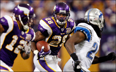 Adrian Peterson led the Vikings to victory over Detroit Sunday with two touchdowns and 160 yards.
