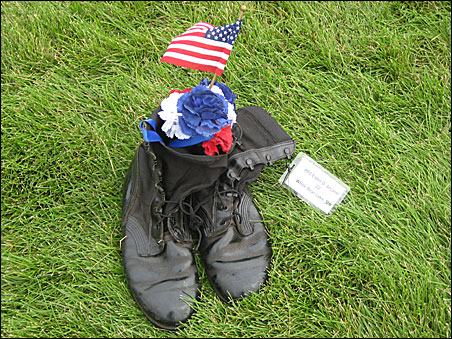 """There was a special display of """"Gold Star boots:"""" the actual boots of fallen soldiers, donated by their families. These boots belonged to Sgt. Thomas J. Sweet II of Bismarck, N.D."""