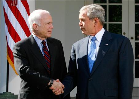 Sen. John McCain and President Bush shake hands at the White House.