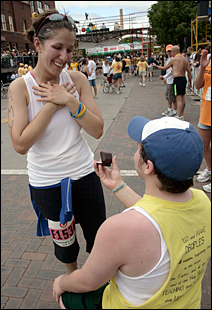 Kyle DeWitt, 24, of Grand Forks, N.D., proposed marriage to Amy Gulka, 24, also from Grand Forks, just after Amy had crossed the finish line.
