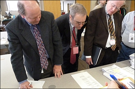 Ramsey County election manager Joe Mansky, Emmer lawyer Michael Toner and Dayton lawyer Tim O'Brien examined ballots on Tuesday.