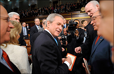 President Bush signs autographs for members of Congress after delivering his speech Monday night.