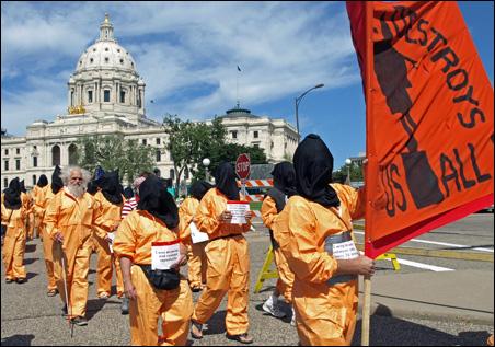 Demonstrators march past the Minnesota Capitol.