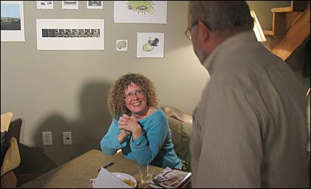 Laurie Hertzel signing a book for former Star Tribune copy editor Dick Parker.