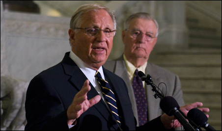 Former Gov. Arne Carlson speaks to the media Tuesday morning as former Vice President Walter Mondale looks on.