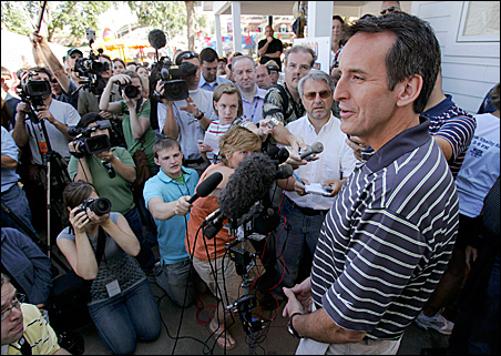 Gov. Tim Pawlenty speaks to reporters at the State Fair on Friday.