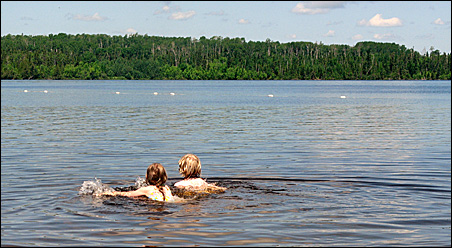 Our kids, Maia and John, swim in White Lake at White Lake Provincial Park in Ontario.
