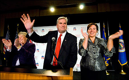 Tom Emmer greeting supporters Tuesday night with running mate Annette Meeks, left, and wife Jacquie.