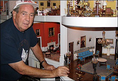 John Zweifel checks out the blue room in the miniature White House that he built and has maintained since 1962.