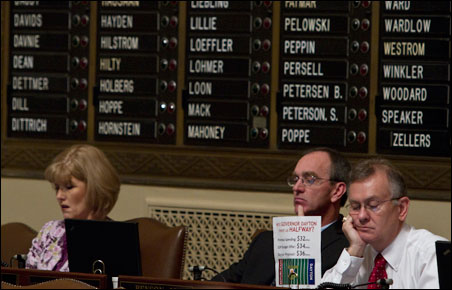 House members while away the last hours awaiting the session's anticlimactic end.