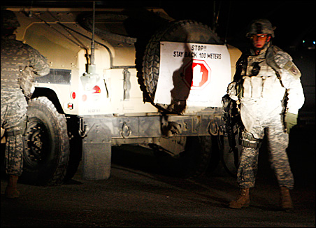 U.S. soldiers keep watch near the Serena Hotel following a Jan. 14 suicide bomb attack that killed eight in Kabul, Afghanistan.
