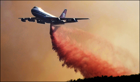 A Boeing 747 makes a flame retardant drop in Acton, Calif., Aug. 31, 2009.