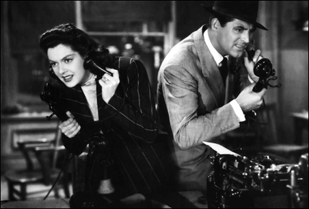 """Rosalind Russell and Cary Grant wonder whose line it is in """"His Girl Friday."""""""