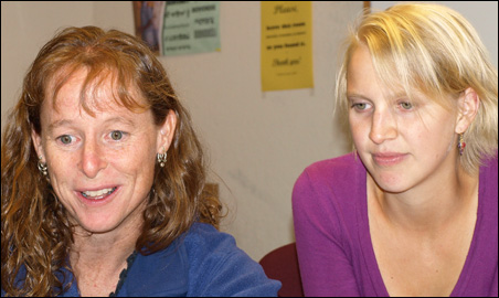 Janet Lewis Muth reviews plans with Sara Doyle, an AmeriCorps Vista worker.