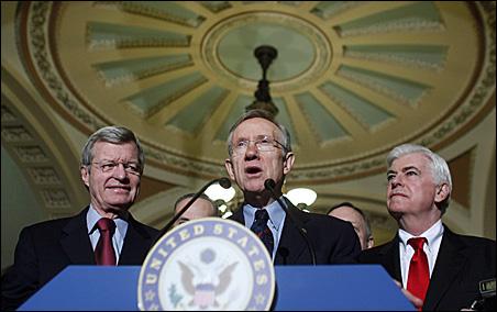 Senate Majority Leader Harry Reid, center, makes a statement following the Senate approval of healthcare legislation on Thursday.