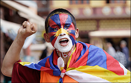 """A Tibetan shouts """"Free Tibet"""" during anti-China rallies Sunday in Kathmandu. The capital of Nepal is home to about 20,000 Tibetan refugees, who were forced into exile in 1959."""