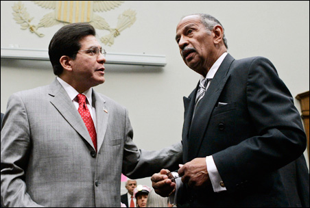 Then-Attorney General Alberto Gonzales and Rep. John Conyers meet in 2007.