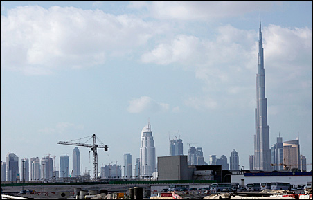 At 2,700 feet tall, the Burj Dubai Tower can be seen from 10 miles away.