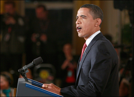 President Barack Obama focused on his economic stimulus plan during an hourlong prime-time press conference.