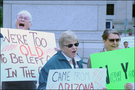 A group of vacationers protests Minnesota's government shutdown.