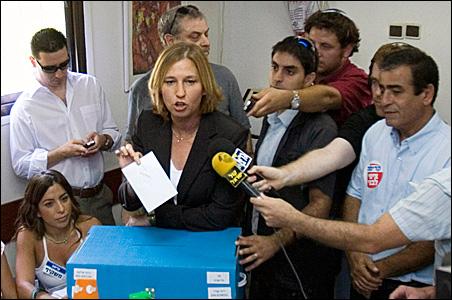 Israeli Foreign Minister Tzipi Livni speaks before casting her ballot at a polling station in Tel Aviv.